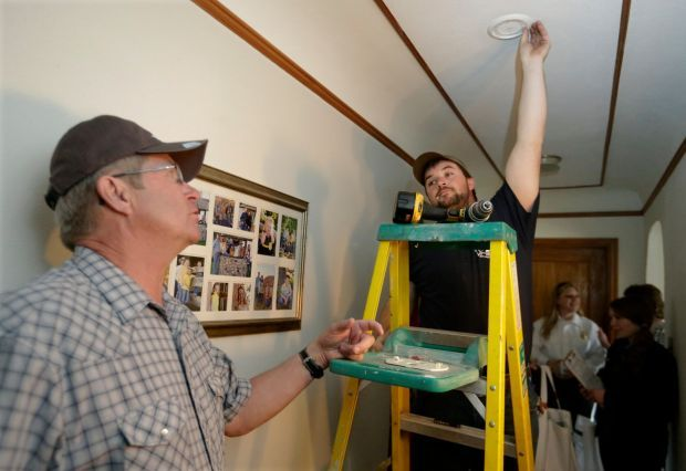 Worden Fire Department and volunteers install fire alarms